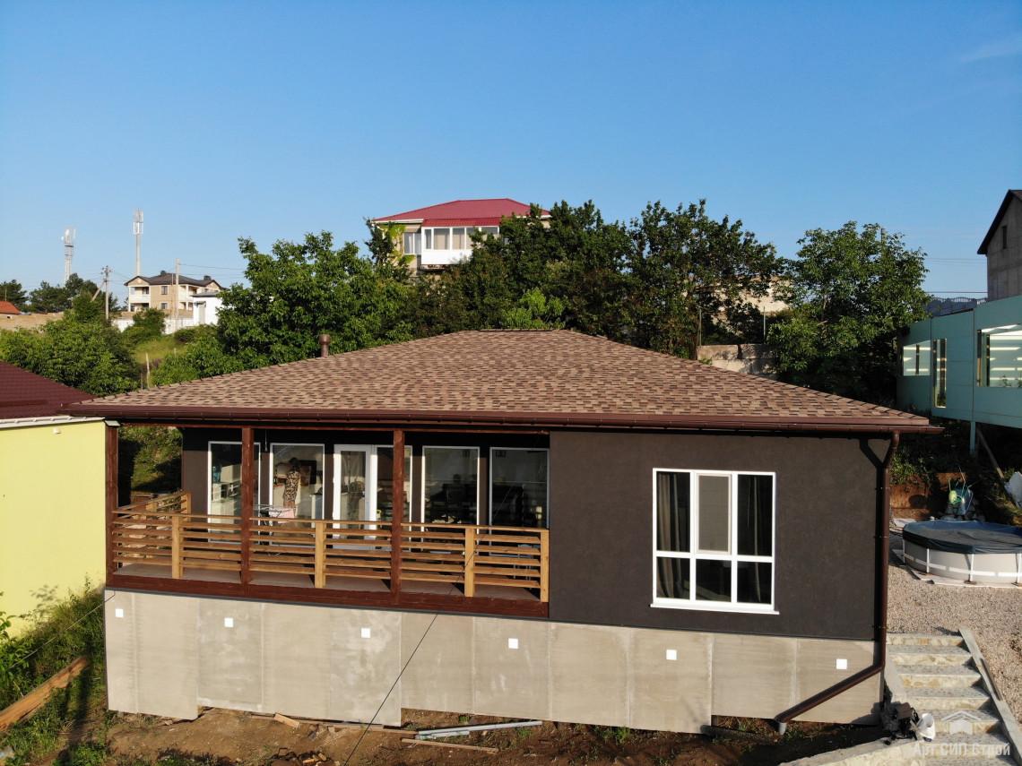 Дом из СИП панелей с отделкой короед
